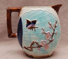 Majolica pitcher, bird in flight: