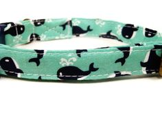 This collar is adorned in a lovely soft mint cotton adorned with navy blue whales. Definitely perfect for the Summer! Weve topped off this nautical