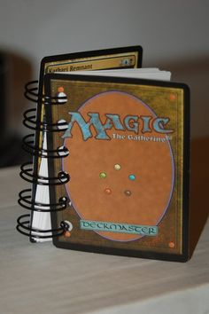 MTG notebook. Byron could write his vows inside, and I could read mine from inside an HP book?