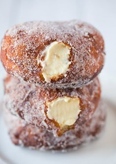 Start your holiday tradition with these warm sugar crusted donuts filled with cream.  Homemade donuts are made with lots of love that the family will enjoy.