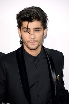 Back on form: Zayn Malik was back on form when he attended the American Music Awards with his fellow band-mates in California on Sunday