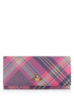 New for Autumn/Winter 2013-14, brighten up your accessories with Vivienne Westwood's vibrantly produced Mac Rock tartan wallet. With a golden Orb to the front and press stud fastening, this piece opens to reveal a soft black leather lining and space to hold eight cards along with a full length zip closing coin compartment and three note/receipt slots.