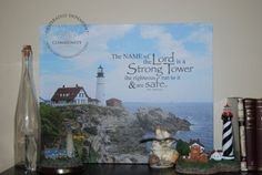 The name of the Lord is a Strong Tower... Prov 18:10 Digital File by DesignVerses on Etsy overlaid on original photography of Portland Head lighthouse to create canvas printed by Canvas on Demand.
