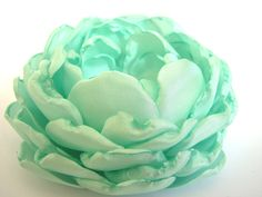 Mint green fabric flower, flower for sash, bridal hair clip, bridesmaids accessories, bridesmaid sash. $24.00, via Etsy.