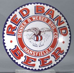 Large round sign for Red Band Beer from The Renner & Weber Brg. Company showing in the center an eagle sitting upon a barrel.