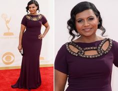 Mindy Kaling wore this deep purple gown by Georges Chakra to the 2013 Emmy Awards. There's something a little Downton about the wavy u...