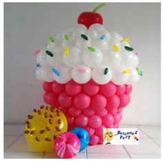 Balloons grouped together to look like a massive cupcake