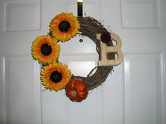 Fall themed stick wreath with sunflowers, pumpkin and letter with felt flower by ReagyLaneDesigns on Etsy