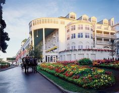"A Grand Entrance, Grand Hotel. Mackinac Island does not allow motorized vehicles, bicycles and horse and carriage carry guest around the island. The movie ""Somwhere in Time"" was filmed at Grand Hotel starring Jane Seymour and Christopher Reeve. The hotel can only be reached by ferry boat or airplane. The hotel sits on a bluff overlooking Lake Huron."