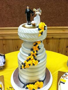 Best wedding cake ever! Its a Stanley cup wedding cake but done elegantly with the flowers along the side