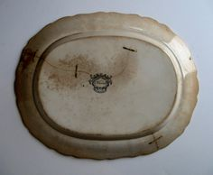 Back view of an early black transfer platter with staple repaired cracks. Collection of Steve Shelton.