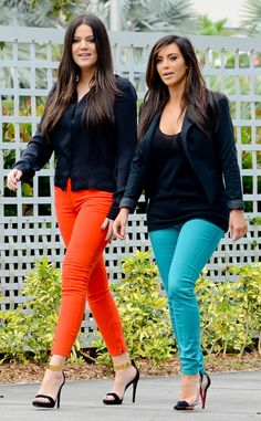Sister-Sister from Khloé Kardashian's Street Style  Stepping out in coordinating outfits, Khloé and sister Kim Kardashian work jewel-toned pants with classic black tops.