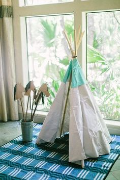"""""""Phoenix loved playing in the teepee his dad, Topher, made him!"""" Jennifer says.  Source: Jennifer Laura Design"""