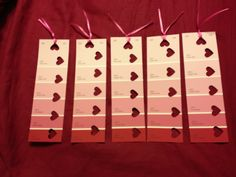 Homemade Valentine's Day bookmarks for cheap! Made these with paint samples, heart hole punch, and ribbon.