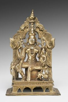 Philadelphia Museum of Art - Collections Object : Ambika Yakshi, A Jain Protective Goddess. Geography: Made in India, Asia Probably made in Rajasthan, India, Asia Date: 1460-1461 Medium: Copper alloy with silver inlay Dimensions: 7 1/2 × 4 9/16 × 2 7/8 inches (19.1 × 11.6 × 7.3 cm) Curatorial Department: South Asian Art Object Location: Currently not on view  Accession Number: 1927-18-2 Credit Line: Gift of Mrs. J. Norman Henry, 1927