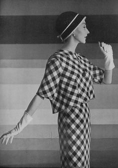 Harper's Bazaar, February 1958    Model is wearing a navy-blue and white checked suit by Monte-Sano & Pruzan.