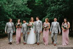 Bridal party photography, blush bridesmaid dresses and light gray suits