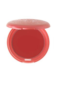 """Stila Cosmetics Convertible Color in Poppy - """"I love the look of flushed cheeks and blush you can actually see. This red definitely mimics a real flush, but it's important you don't overapply. Stila's resident beauty genius, Sarah Lucero, showed me exactly how to use it so I get the look I want: tap your middle finger in the blush five times, then against your thumb five more times. You're left with the perfect amount of color to pat onto the cheek."""""""