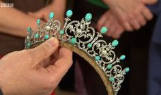 a lovely diamond and cabochon turquoise tiara, which popped up on the BBC. Featuring five diamond foliate scroll motifs, each with a central button pearl, plus oval turquoise cabochons top and bottom, and similar on the diamond pinnacle spacers