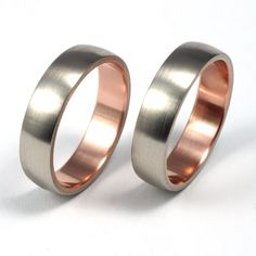 for him...white gold wedding bands with rose gold inside to match your ring <3