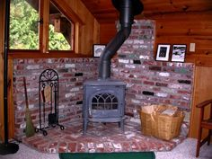 This is the hearth I want to put in for the wood stove. The stove will be black and the crick will be red. Corner Wood Stove, Wood Stove Hearth, Granite Hearth, Brick Hearth, Stove Fireplace, Wood Burner, Franklin Stove, Antique Wood Stove, Cooking Stove