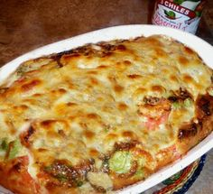 Mexican Egg Casserole from Food.com:   Tomatoes and green chilies add color to this dish. This cheesy egg dish has a zip to it. It makes a great breakfast, brunch or even lunch or casual dinner dish.