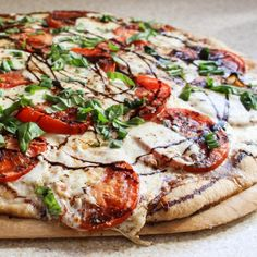 Caprese Goat Cheese Pizza with Caramelized Onions & Peppers. A special pizza that is quick and easy to throw together!