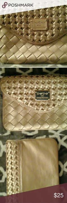 Bebe  clutch This is a reposhed  item but just didn't go with anything I own. Very nice condition 9/10.  Magnetic clasp works very well to keep closed. Also has zipper to keep everything inside. Very Small blemish inside lining  of one of the pockets. Perfect for the holidays! bebe Bags Clutches & Wristlets