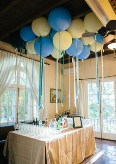Love this bar with all the balloons floating above - this was for a baby shower featured on 100 Layer Cakelet, but could easily work for a number of parties