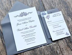 Plum and gray letterpress wedding invitation with floral accents, by Lucky Invitations.