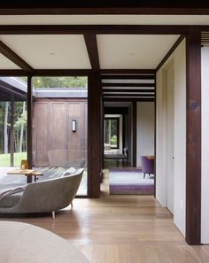 A rural retreat for an acclaimed international clothing designer and her husband.  The house is inspired by traditional Japanese architecture. The structure is formed of exposed heavy timber construction, a rarity today, which, in addition to its natural beauty, has the added advantage of reducing the need for interior walls. The load-bearing timber beams span the interiors and, with their darkened hues, recede from view as they frames the floor-to-ceiling windows that overlook the gardens…