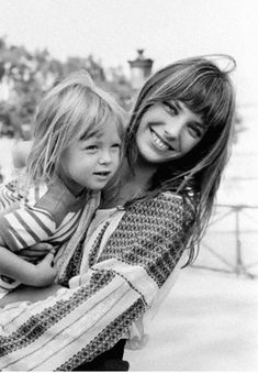 Jane Birkin and Charlotte Gainsbourg. She looks so great it bangs, she almost makes me want to get my hair cut into bangs again.