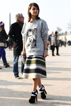 Très Chic! The Best Street Style at Paris Fashion Week: Jewel tones and statement jewels gave this trouser and top look a high-wattage twist.  : Miroslava Duma perfected sportif-chic in a sweatshirt, flared skirt, and platforms outside the shows.