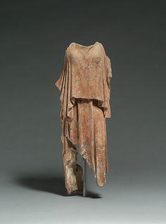 Terracotta figure of a woman.  Period:     Classical. Date:     mid-5th century B.C. Culture:     Greek. Medium:     Terracotta. Dimensions:     H. 17 3/4 in. (45 cm).