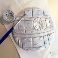 A fondant Death Star with silver luster dust!