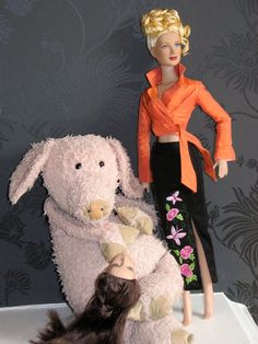 Colin the Pig poses alongside Betty Ann. Emilie told him not to, hence her decapitated head. Colin likes to model.
