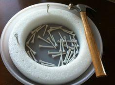 Hammering center - Styrofoam ring, lid, golf tees and a small hammer