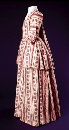 Side view, caraco and petticoat, probably Amsterdam, 1760-1790. Block-printed cotton with a design of meandering red stripes and flowers.