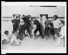 "Children learn the art of boxing in the ""'Manly art of self-defense"" Newsboys' Protective Association.  Location: Cincinnati, Ohio,' 1908. Library of Congress, USA."