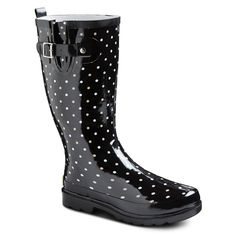 A women's classic polka-dot print with easy-on and off back pulls. A treaded sole provides stabilizing traction and side buckle puts this boot on trend. This fun dot pattern makes this women's waterproof rain boot a must-have item.