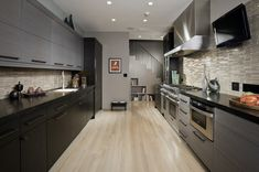 long narrow kitchen wide work area in this galley kitchen by Fredman Design Group Long Narrow Kitchen, Galley Kitchen Design, Contemporary Kitchen Design, Kitchen Photos, Kitchen Ideas, Transitional Kitchen, Transitional Style, Black Kitchens, Kitchen Flooring