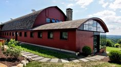 The three-bedroom is situated on 46 acres of fields and orchards, with land suitable for raising animals or cultivating agriculture, and boasts many details of its former use, including over 7,000 square feet of reclaimed redwood, chestnut, and cypress wood, and a sloping roof.