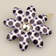 """Vignette Violet Petal - Cubitas Picabia Collection (Hand-set Swarovski Crystals, Hair Pin) by Cubitas. $12.50. Dimensions: 2.625""""(length) x 2.375""""(width) x 0.5""""(depth). High-quality lead-free plastic with glossy finish, including hypoallergenic gold-plated metal pin. Classic barrette style closure with """"gripper teeth""""; Designed to hold a small section of hair. One large clear hand-set Swarovski crystal surrounded by a ring of smaller sparklers. Petal Power! Our Vig..."""