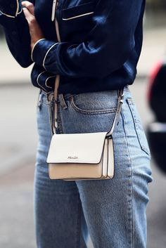 Pajama dressing is still cool — case in point.Prada bag. #refinery29 http://www.refinery29.com/2016/09/123831/lfw-spring-2017-best-street-style-outfits#slide-38