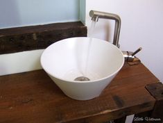 There isn't going to be a whole lot of instruction in this post, because it's not really needed. To make the vessel sink, we used a serving bowl, a chrome pipe kit (similar to this) and sink drain. Bathroom Sink Bowls, Diy Bathroom Vanity, Small Bathroom Storage, Diy Vanity, Bathroom Furniture, Bathroom Ideas, Bathroom Things, Dream Bathrooms, House Furniture