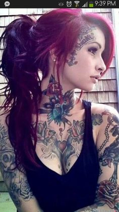 Not sure about the face tattoos but I looove her style! beautiful!