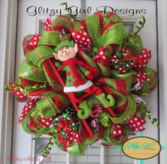 This wreath is adorable! This has a cute elf climbing a ladder and oops he dropped the gifts.. This wreath is made out of deluxe green and red