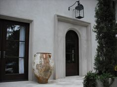 The entry to an Atlanta house renovation designed by my friend Rodolfo Castro. This house really sparked my interest in architecture and design several years ago and continues to be one of my favorites. Exterior Colors, Exterior Design, Interior And Exterior, Villa, Olive Jar, Gas Lanterns, Atlanta Homes, Cast Stone, Front Entrances