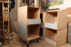 stackable shelving unit with drawers. on wheels. made from OSB and locker doors from abandonned wine factory.