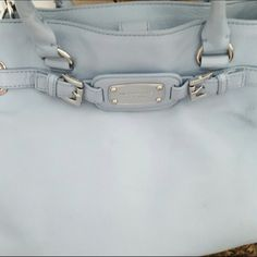 Michael kors purse Beautiful light blue Michael kors satchel purse. Gently used but in amazing condition. Perfect for spring. Retails for $325 asking $200 Obo. Michael Kors Bags Satchels
